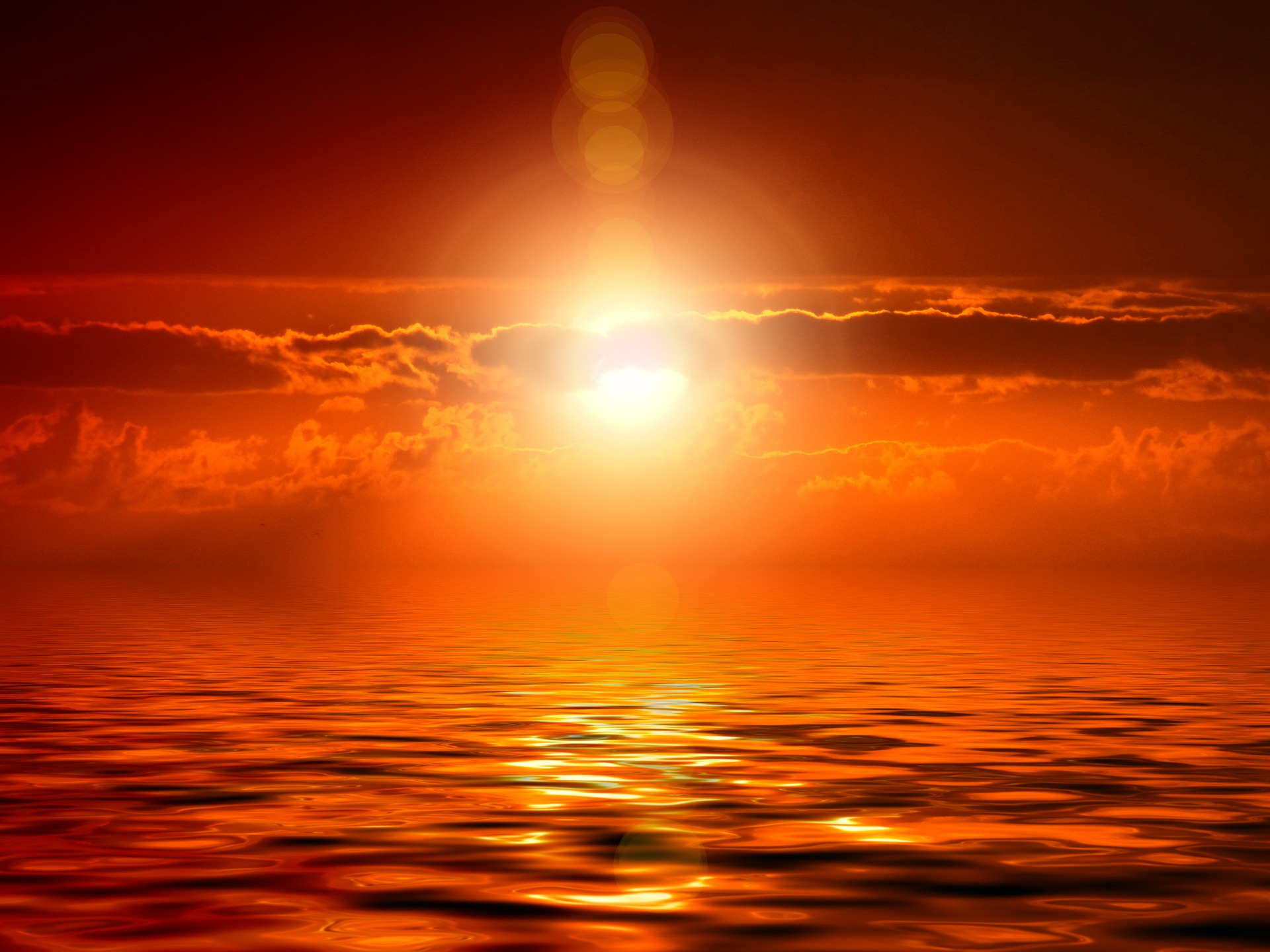 Image of sun setting over horizon